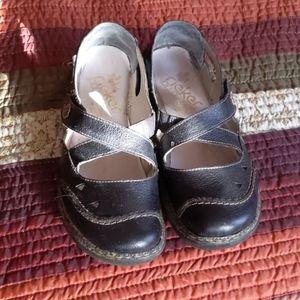 Ladies Rieker black flat cross front shoes